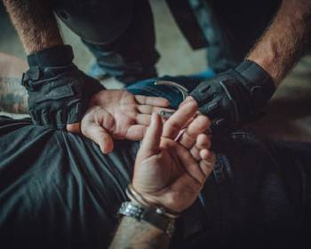 police-putting-handcuffs-on-a-man